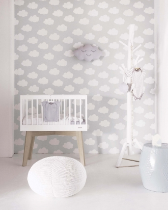 White cot with cloud wallpaper