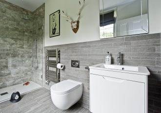 Grey boys bathroom with Banksy picture