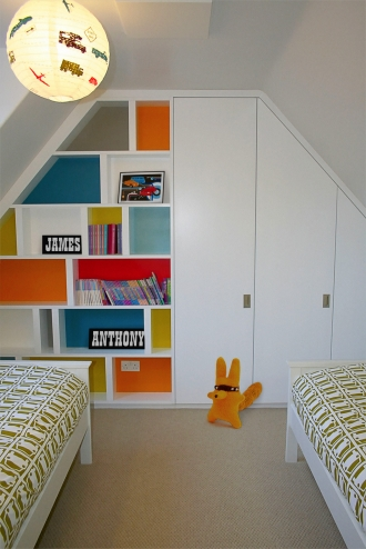 Built in wardrobes, storage, cool colours in children's bedroom