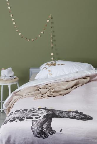 girls bed linen in green room