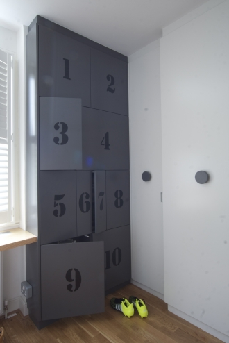 Grey wardrobes, storage in boy's bedroom