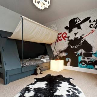 Cool graffiti wallpaper and tent bed in boy's room